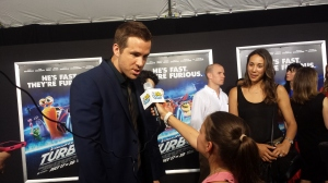 Ryan Reynolds and cute kid reporter